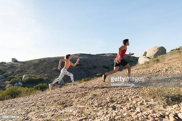 Beautiful Hispanic Couple Running Uphill