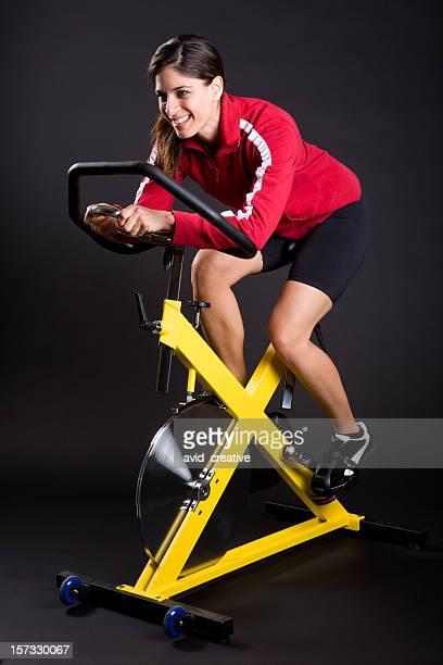 Beautiful Hispanic Girl Exercising on Spin Cycle