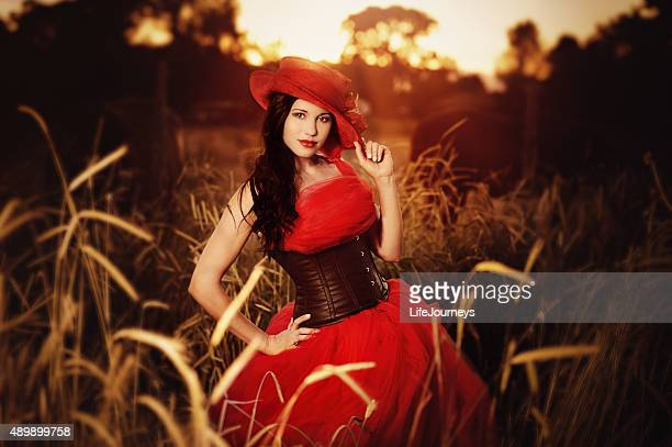 Beautiful Hispanic Woman in Red Tulle Dress And Leather Corset