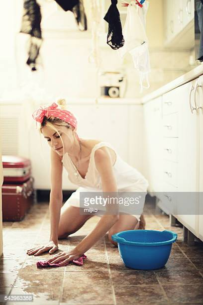 Beautiful housewife doing home jobs