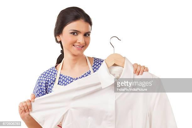 beautiful housewife showing a shirt