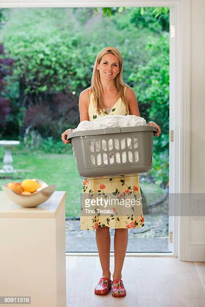 Beautiful housewife with fresh laundry