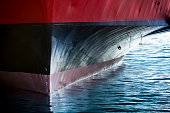 A beautifull horizontal graphic view of the bow of a large ship in port. It would make a great image forf anything involving international shipping; transportation; industrial cargo or ferry.