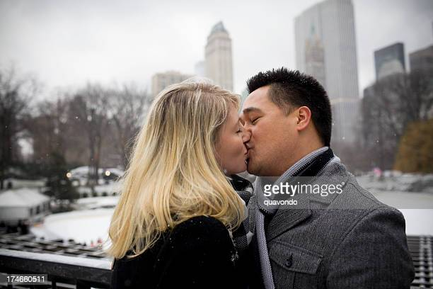 Beautiful Interracial Young Couple Kissing in Snowy Central Park