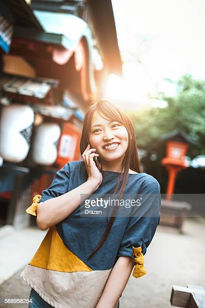Beautiful Japanese girl with cell phone