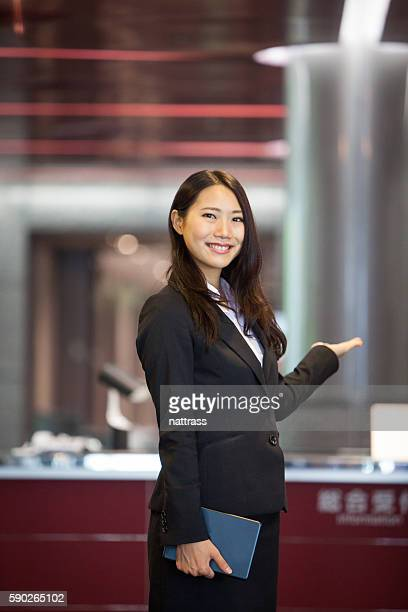 Beautiful Japanese woman greeting at the hotel entrance