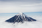 Beautiful Koryaksky volcano in Kamchatka with the snow peak above the clouds