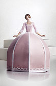 Beautiful lady in large pink paper craft dress