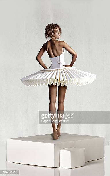 Beautiful lady in white paper ballerina dress