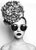 Black and white portrait of beautiful lady with hydrangea