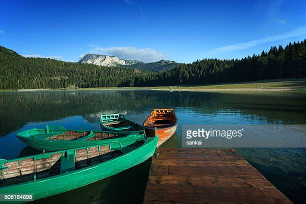 Beautiful lake in mountains and wooden boats at the pier