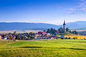 Beautiful landscape of valley in Slovakia mountains, small houses in village, rural scene. Spissky Stvrtok, Slovakia