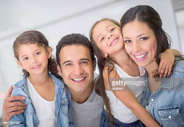 Beautiful Latin American family at home