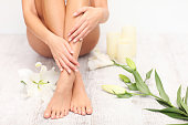 Woman in spa. Beauty treatment. Perfect skin. Pedicure.