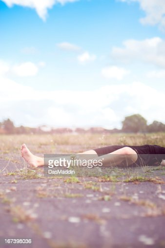 Beautiful legs of a young girl laying on the ground : Bildbanksbilder