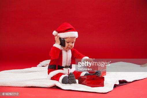 Beautiful little baby celebrates Christmas. New Year's holidays. with : Foto de stock