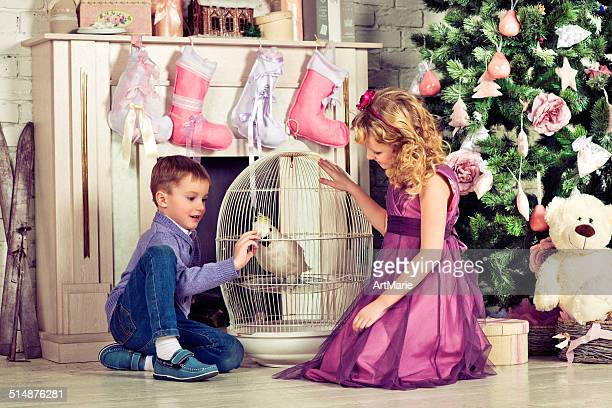 Beautiful little boy and girl with Christmas gifts