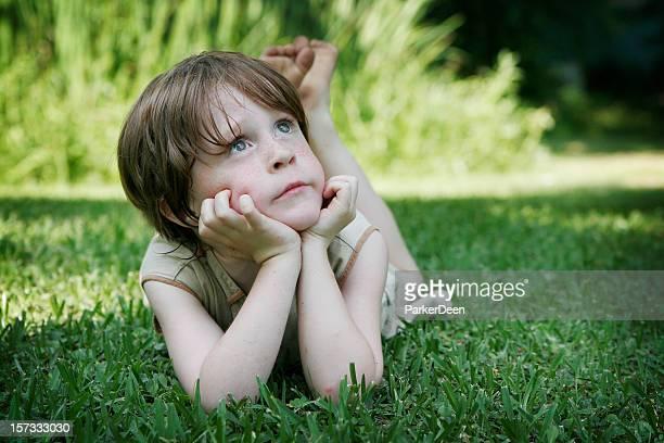 Beautiful Little Boy Laying in Grass