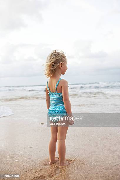 Beautiful little girl at the beach enjoying view