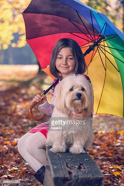 Beautiful little girl having fun in autumn forest