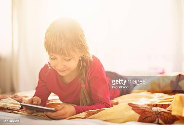 Beautiful little girl using digital tablet