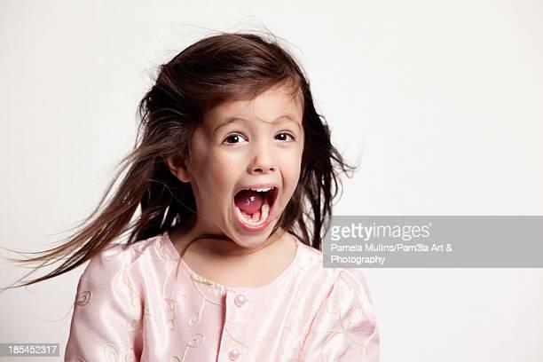 Beautiful little girl yelling