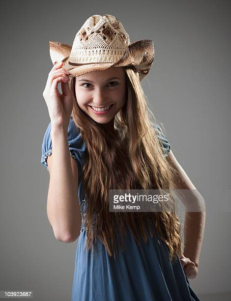 Beautiful long haired cowgirl tipping her hat