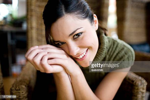 Beautiful Lovable Young Woman Portrait, Smiling at Camera, Hands Clasped