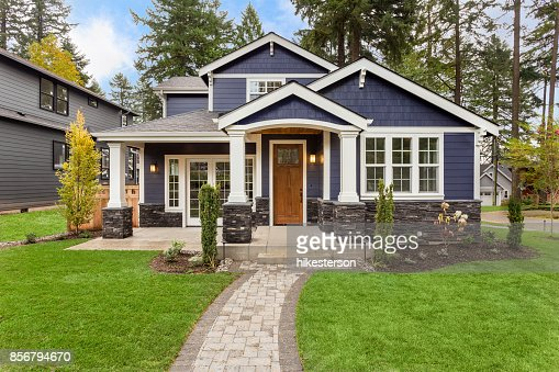 Beautiful Luxury Home Exterior with Green Grass and Landscaped yard : Stock Photo