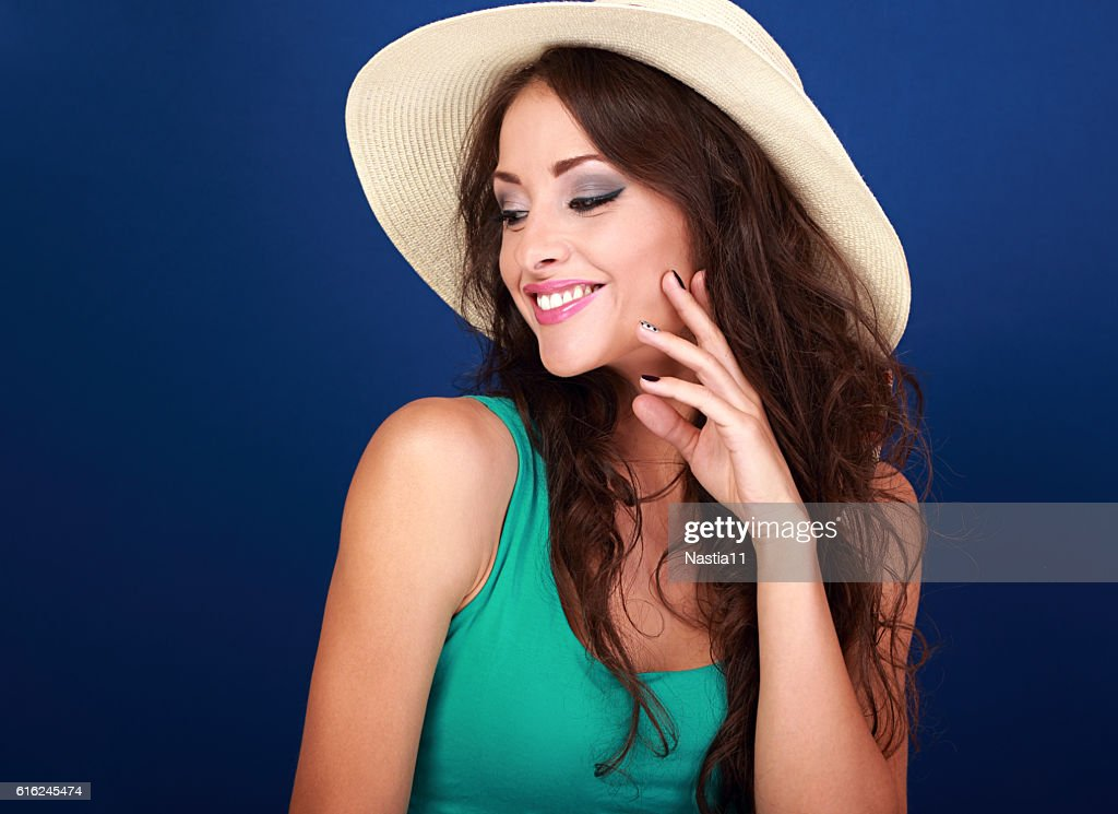 Beautiful makeup smiling woman in summer hat with curly hair : Stock Photo
