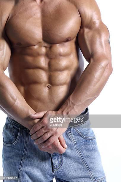 Beautiful male body in blue jeans