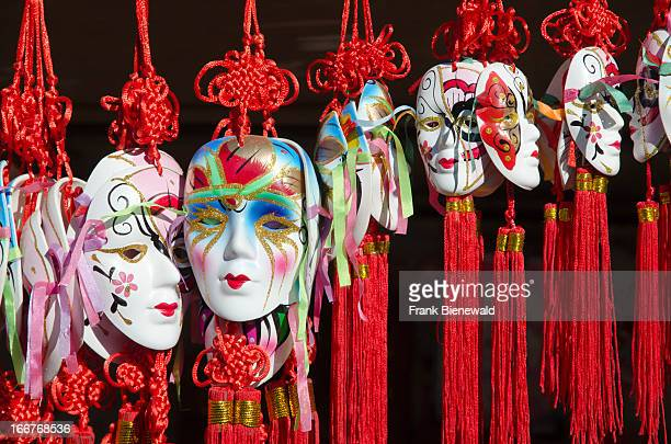 Beautiful masks for souvenir are sold in giftshops outside of temples