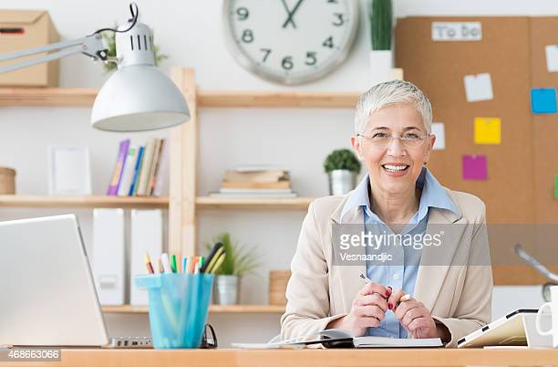 Beautiful mature business woman at office working