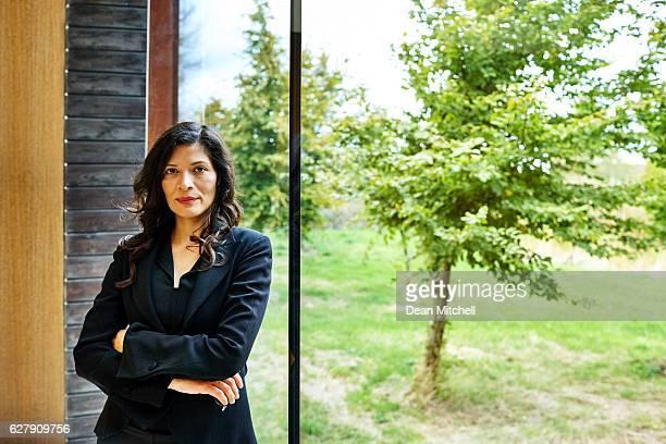 Beautiful mature businesswoman standing confidently