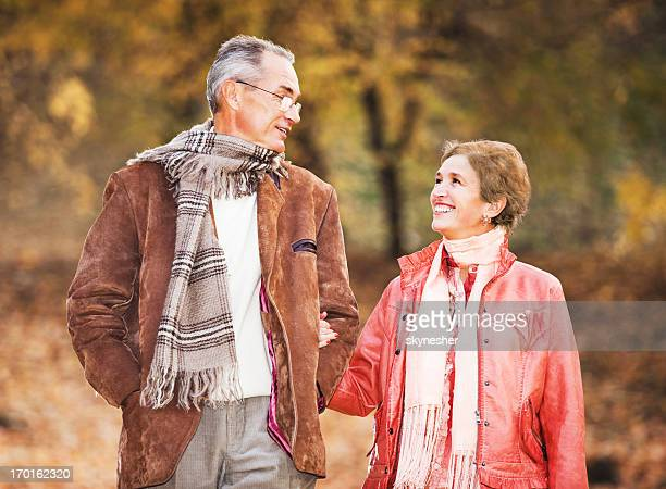Beautiful mature couple walking in park.