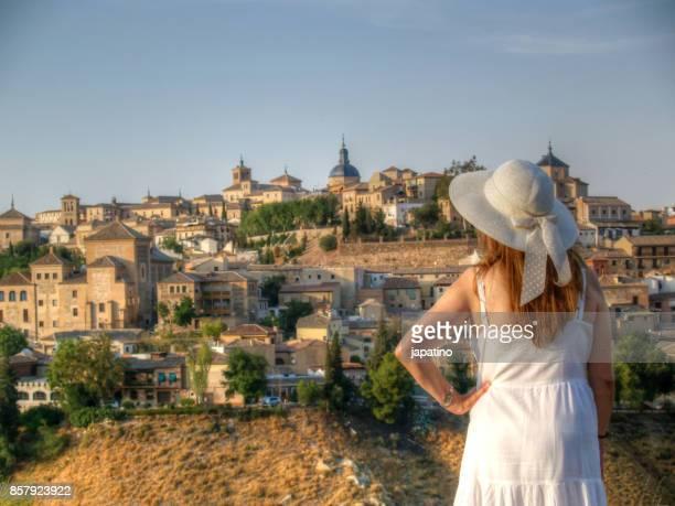Beautiful mature woman watching the city of Toledo