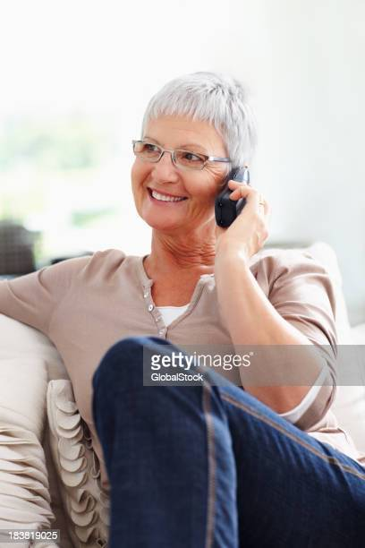 Beautiful mature woman with telephone