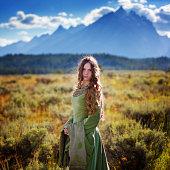 Beautiful medieval princess with mountain range