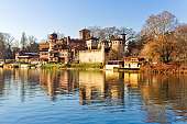 Po river, panoramic view of the beautiful Medieval Village built in the park of Valentino, Turin, in Piedmont, Italy.