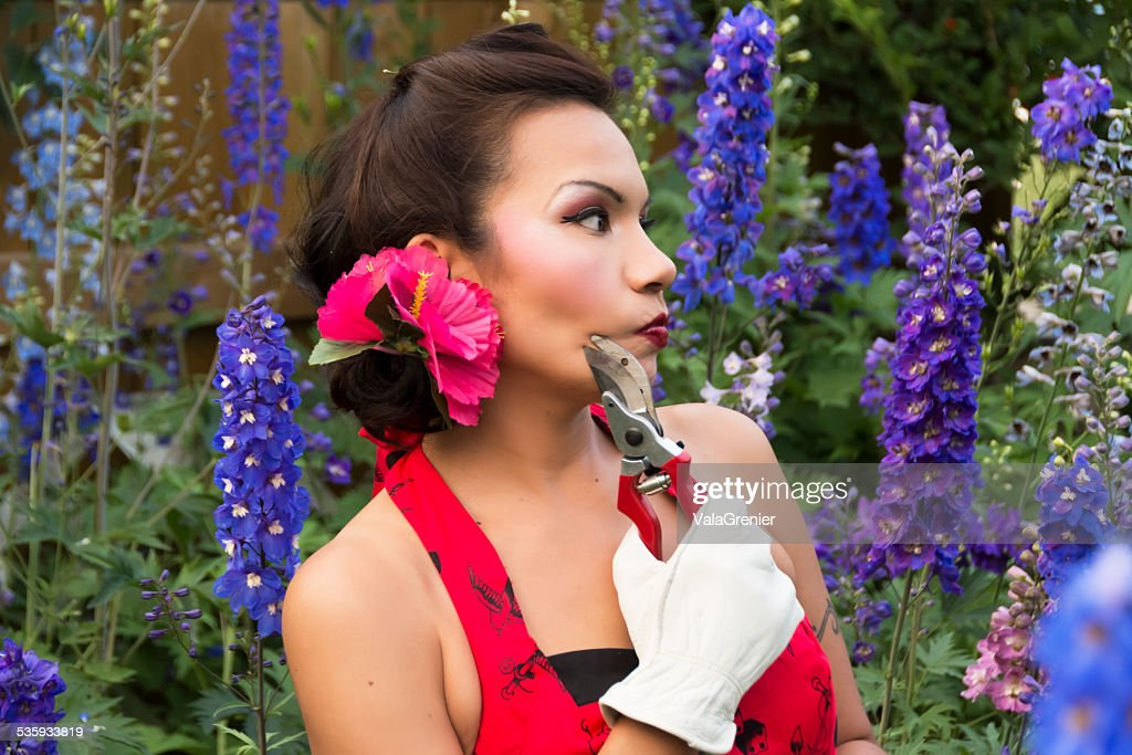 Beautiful mid adult  woman contemplating where to start gardening. : Stock Photo