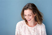 Close up portrait of a beautiful mid adult woman laughing with sweater