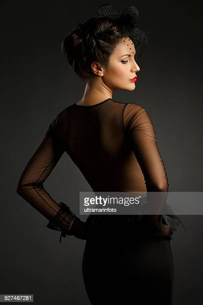 Beautiful mid adult women wearing black gown  Glamourous retro diva