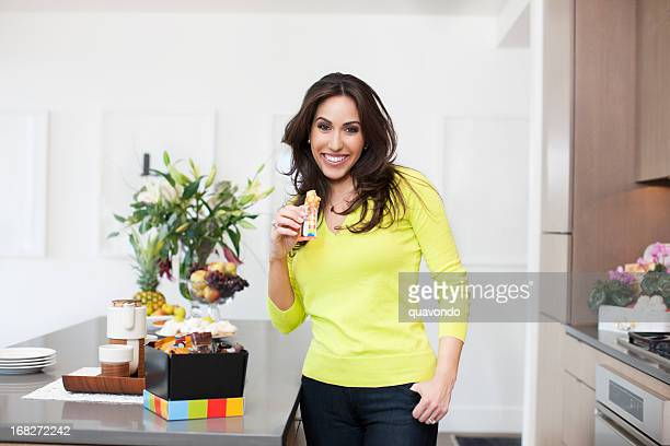 Beautiful Middle Eastern Woman Promoting Healthy Eating in Home Kitchen
