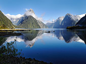 Standing at the Milford Sound New Zealand