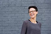 Portrait of a beautiful mixed race woman laughing with glasses