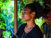 Melanesian model in black blouse looking at camera