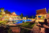 Modern resort with swimming pool at night