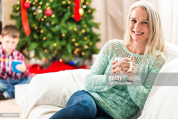 Beautiful modern grandmother relaxes on Christmas day