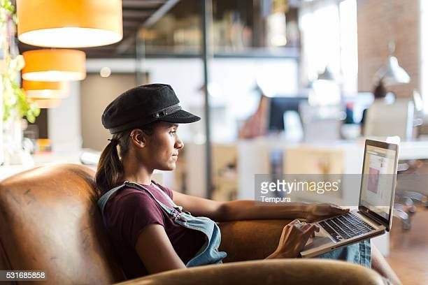 Beautiful modern woman working with her laptop
