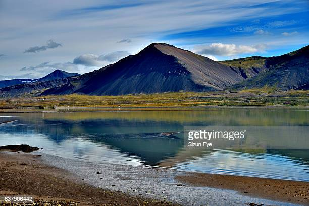 Beautiful mountain range with reflections in water in Borgarnes, Iceland.